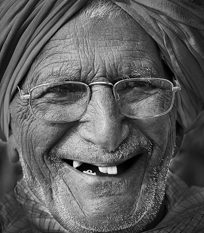 Wry Smile ,    of a Haryanvi  –  India